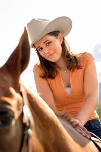 Mädchen auf einem Pferd